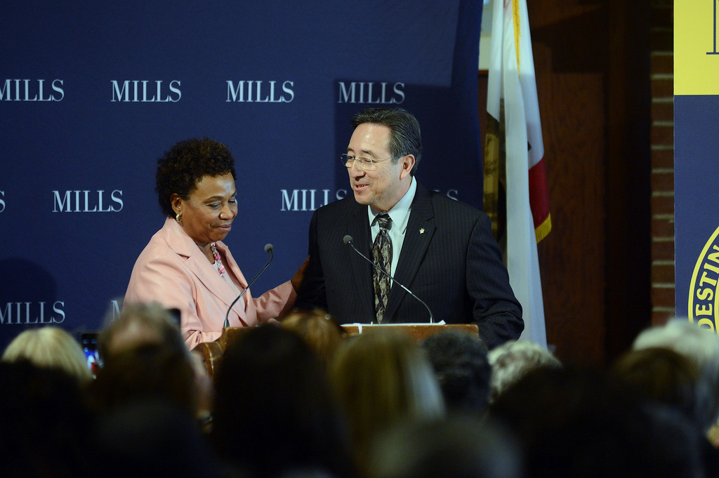 . Congresswoman Barbara Lee, left, welcomes Daryl Trujillo, Oakland Postmaster, to the podium at a forum on women\'s economic empowerment and unveiling of a commemorative stamp honoring Shirley Chisholm held at Mills College in Oakland, Calif., on Saturday, Feb. 1, 2014. The forum and unveiling featured Mills alum Congresswoman Barbara Lee and Congresswoman Nancy Pelosi, among others. Shirley Chisholm was the first African American elected to Congress. (Dan Honda/Bay Area News Group)