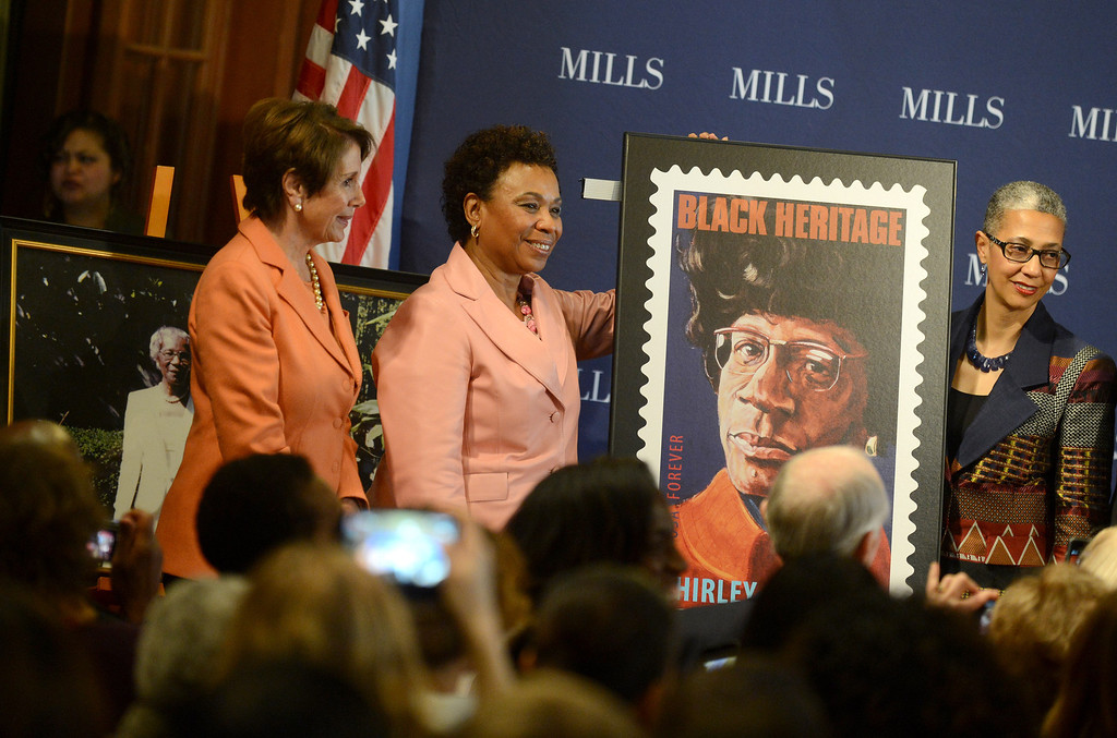 . Congresswoman Nancy Pelosi, left, Congresswoman Barbara Lee, center, and Mills College president Alecia A. DeCoudreaux, right, unveil the new Shirley Chisholm stamp at a forum on women\'s economic empowerment and unveiling of a commemorative stamp honoring Shirley Chisholm held at Mills College in Oakland, Calif., on Saturday, Feb. 1, 2014. The forum and unveiling featured Mills alum Congresswoman Barbara Lee and Congresswoman Nancy Pelosi, among others. Shirley Chisholm was the first African American elected to Congress. (Dan Honda/Bay Area News Group)