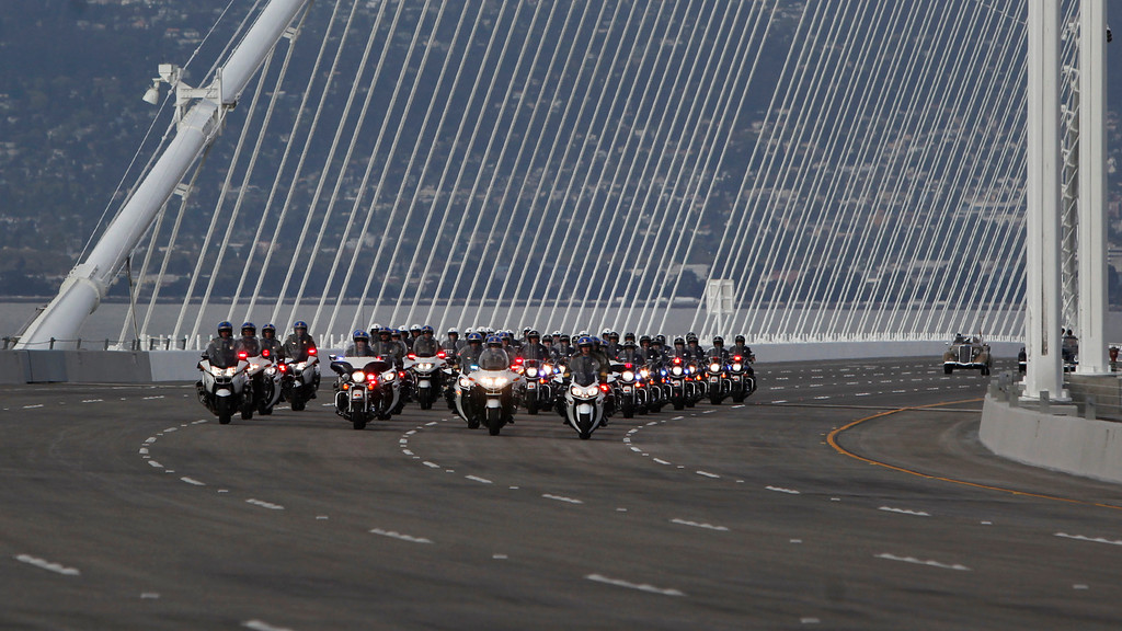 . A procession of California Highway Patrol motorcycle officers leads a vehicle carrying Lt. Gov. Gavin Newsom first vehicles over the new Bay Bridge after a chain-cutting bridge-opening ceremony Monday afternoon, Sept. 2, 2013 between Oakland and San Francisco, Calif. After 24 years of waiting, the Bay Area finally has its new bridge.   (Karl Mondon/Bay Area News Group)