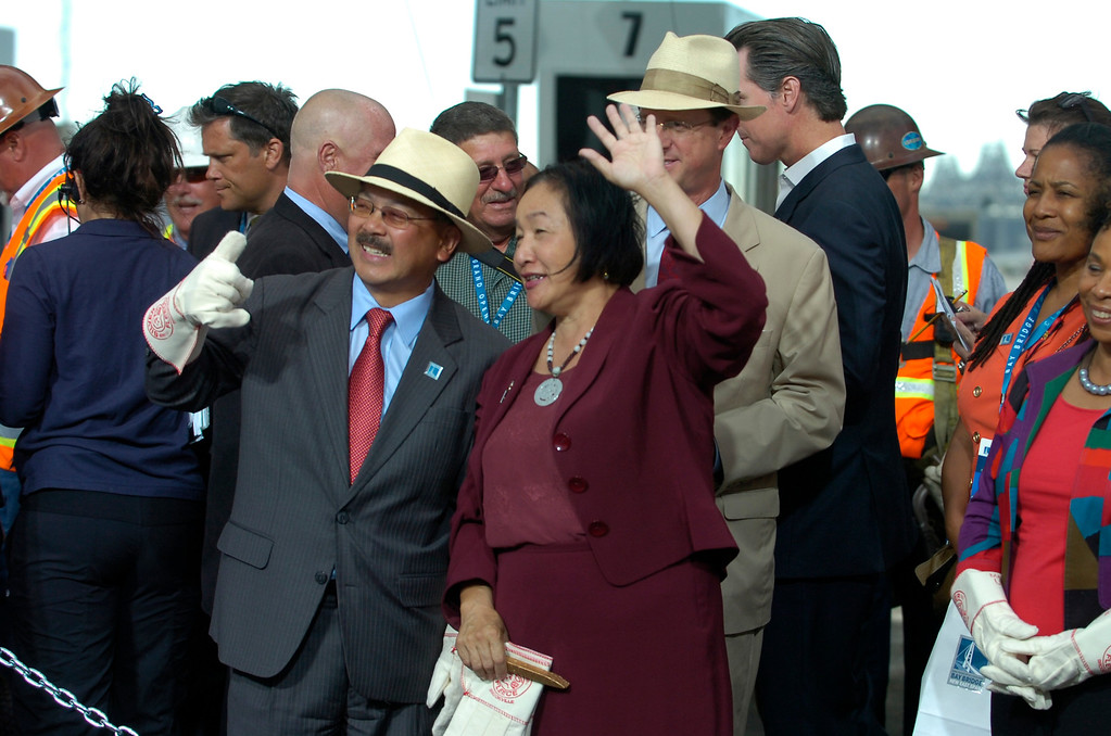 . San Francisco Mayor Ed Lee, left, and Oakland Mayor Jean Quan take part in a chain-cutting ceremony to celebrate the completion of the new Bay Bridge in Oakland, Calif., on Monday, Sept. 2, 2013. (Kristopher Skinner/Bay Area News Group)