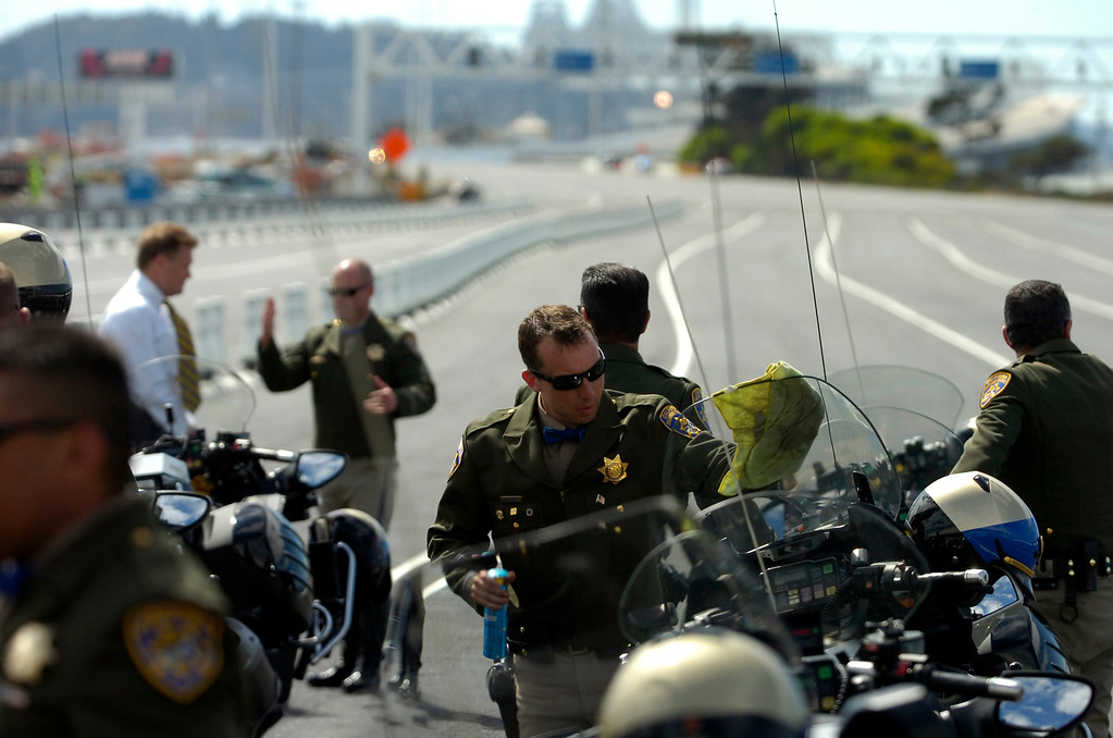 . Motorcycle police officers prep their vehicles prior to a chain-cutting ceremony to celebrate the completion of the new Bay Bridge in Oakland, Calif., on Monday, Sept. 2, 2013. (Kristopher Skinner/Bay Area News Group)