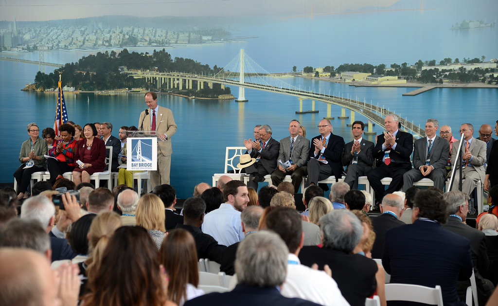 . Steve Heminger, executive director of the Bay Area Toll Authority, speaks during a grand opening ceremony for the Bay Bridge Monday afternoon Sept. 2, 2013, in Oakland, Calif. After 24 years of waiting, the Bay Area has a new bridge.   (Karl Mondon/Bay Area News Group)