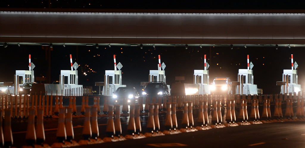 . Some of the first paying customers make their way through the toll plaza at 10:15, paying down the $6.4 billion tab on the new Bay Bridge after it reopened Monday evening Sept. 2, 2013 in Oakland, Calif. (Karl Mondon/Bay Area News Group)