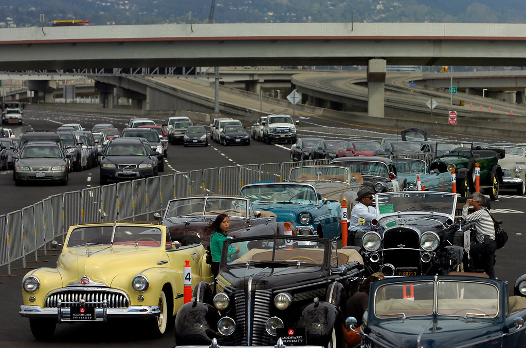 . Classic cars line up for a ceremonial procession across the Bay Bridge prior to a chain-cutting ceremony to celebrate the completion of the new Bay Bridge in Oakland, Calif., on Monday, Sept. 2, 2013. (Kristopher Skinner/Bay Area News Group)