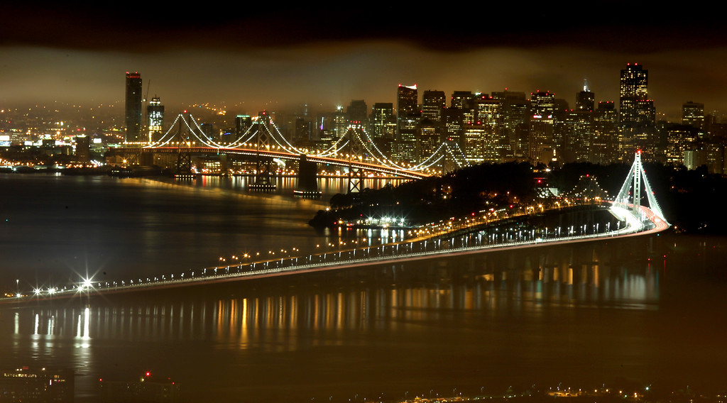 . Streak of lights from motor vehicles cross the new eastern span of the Bay Bridge six hours later it was finally opened as the San Francisco skyline is seen in the background from the Berkeley hills in Berkeley, Calif., on Tuesday, Sept. 3, 2013. (Ray Chavez/Bay Area News Group)
