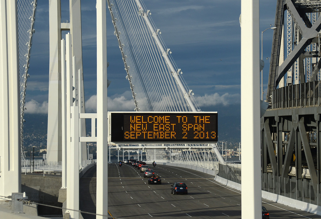 . A procession of vehicles carrying dignitaries heads back to the toll plaza after driving across the new eastern span of the Bay Bridge  Monday afternoon Sept. 2, 2013 in Oakland, Calif.   (Karl Mondon/Bay Area News Group)