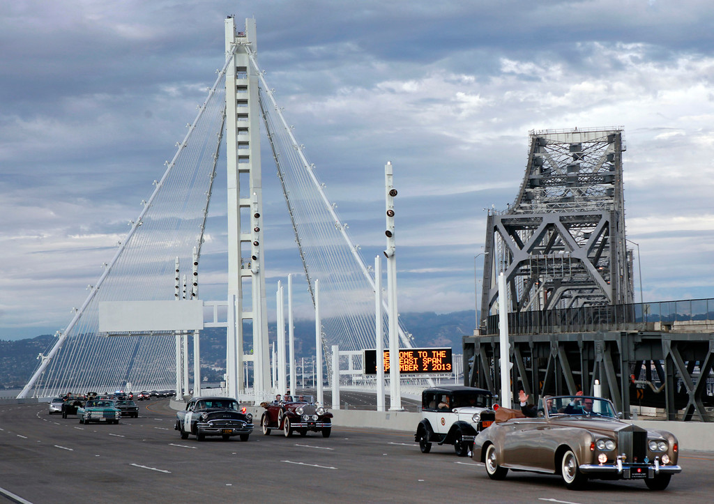 . Vintage vehicles form a procession across the new Bay Bridge after a chain-cutting ceremony Monday afternoon Sept. 2, 2013 in Oakland, Calif. After 24 years of waiting, the Bay Area finally has its new bridge.  (Karl Mondon/Bay Area News Group)