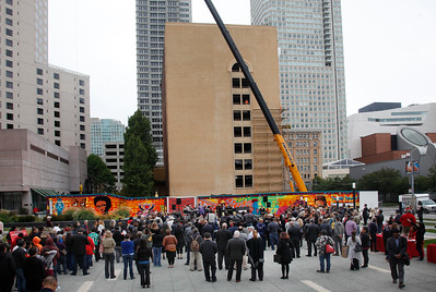 A crane looms behind a dedication ceremony for the Mexican Museum's new site on Mission Street across from the Yerba Buena Gardens in San Francisco, Calif., Tuesday morning, July 19, 2016. The museum will reside in the first four floors of a 510-foot residential tower. (Karl Mondon/Bay Area News Group)