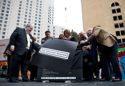 Dignitaries unveil the cornerstone for the new Mexican Museum at a site on Mission Street across from the Yerba Buena Gardens, Tuesday morning, July 19, 2016, in San Francisco, Calif.  The museum will reside in the first four floors of a 510-foot residential tower. (Karl Mondon/Bay Area News Group)