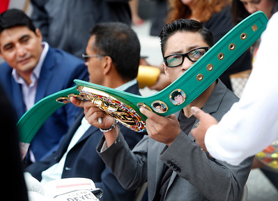 Erik Morales, Robert Guerrero and Israel Vasquez (l-r) autograph a boxing championship belt for donation to the Mexican Museum at a dedication ceremony for the museum's new home, Tuesday morning, July 19, 2016, in San Francisco, Calif.  (Karl Mondon/Bay Area News Group)