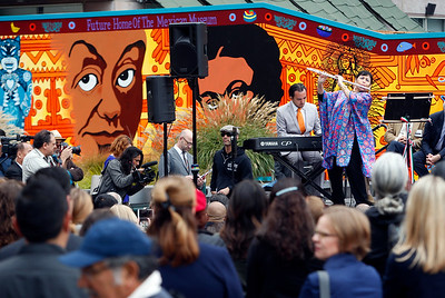 Flautist Elena Duran performs at a dedication ceremony for the new Mexican Museum site on Mission Street across from the Yerba Buena Gardens in San Francisco, Calif., Tuesday morning, July 19, 2016. The museum will reside in the first four floors of a 510-foot residential tower that will be built behind a colorful mural of famous Mexican artists. (Karl Mondon/Bay Area News Group)