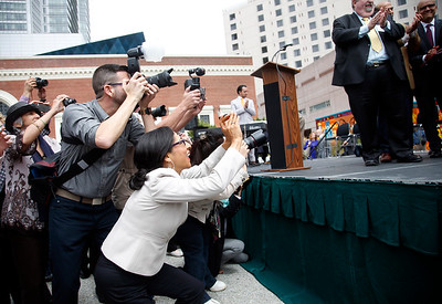 Photographers crowd the stage during the unveiling of the cornerstone for the new Mexican Museum at a site on Mission Street across from the Yerba Buena Gardens, Tuesday morning, July 19, 2016, in San Francisco, Calif.  The museum will reside in the first four floors of a 510-foot residential tower. (Karl Mondon/Bay Area News Group)