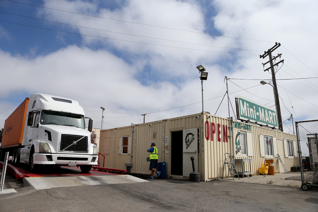. A driver walks back to his rig after getting the tractor trailer truck weighed at the Oakland Port Scale and Mini Mart at the Port of Oakland in Oakland, Calif., on Thursday, Sept. 1, 2016. (Anda Chu/Bay Area News Group)