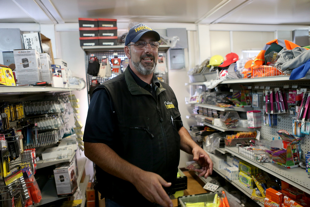 . Owner Bill Aboudi stands in one of the aisles at his Oakland Port Scale and Mini Mart at the Port of Oakland in Oakland, Calif., on Thursday, Sept. 1, 2016. (Anda Chu/Bay Area News Group)