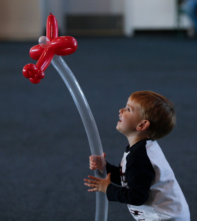 . Ryan Newman, 3, plays with his balloon airplane at the Hiller Aviation Museum in San Carlos, Calif., on Saturday, Jan. 4, 2014. Hundreds of people came out for Open Cockpit Day and got a chance to sit in the cockpit of many of the aircraft on display at the museum. (John Green/Bay Area News Group)