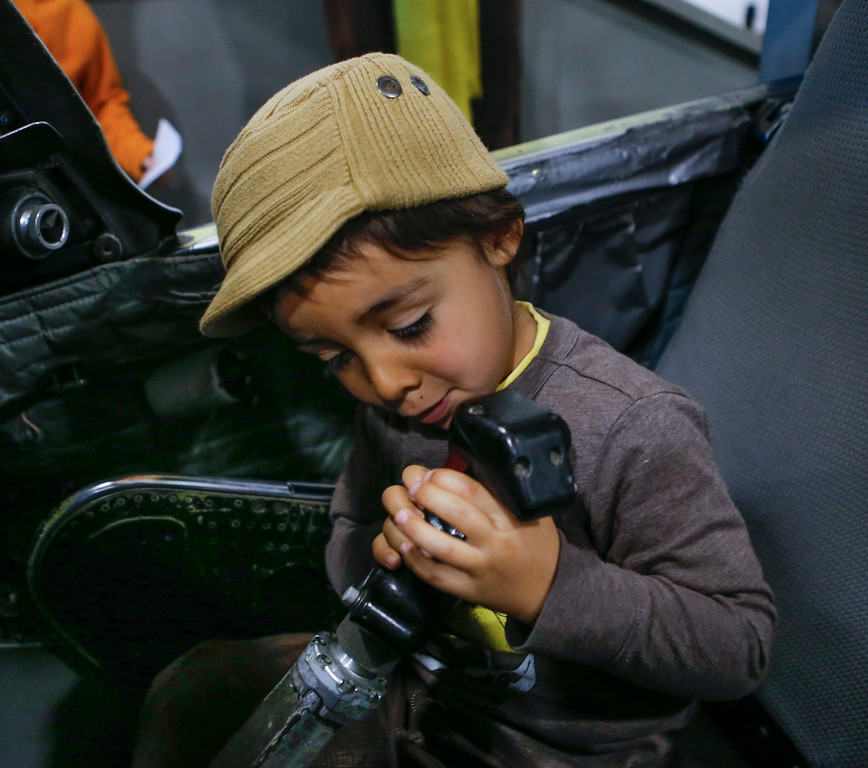 . Nikolai Turienzo Otero, 4, checks out the controls in the cockpit of an F-4 airplane at the Hiller Aviation Museum in San Carlos, Calif., on Saturday, Jan. 4, 2014. Hundreds of people came out for Open Cockpit Day and got a chance to sit in the cockpit of many of the aircraft on display at the museum. (John Green/Bay Area News Group)