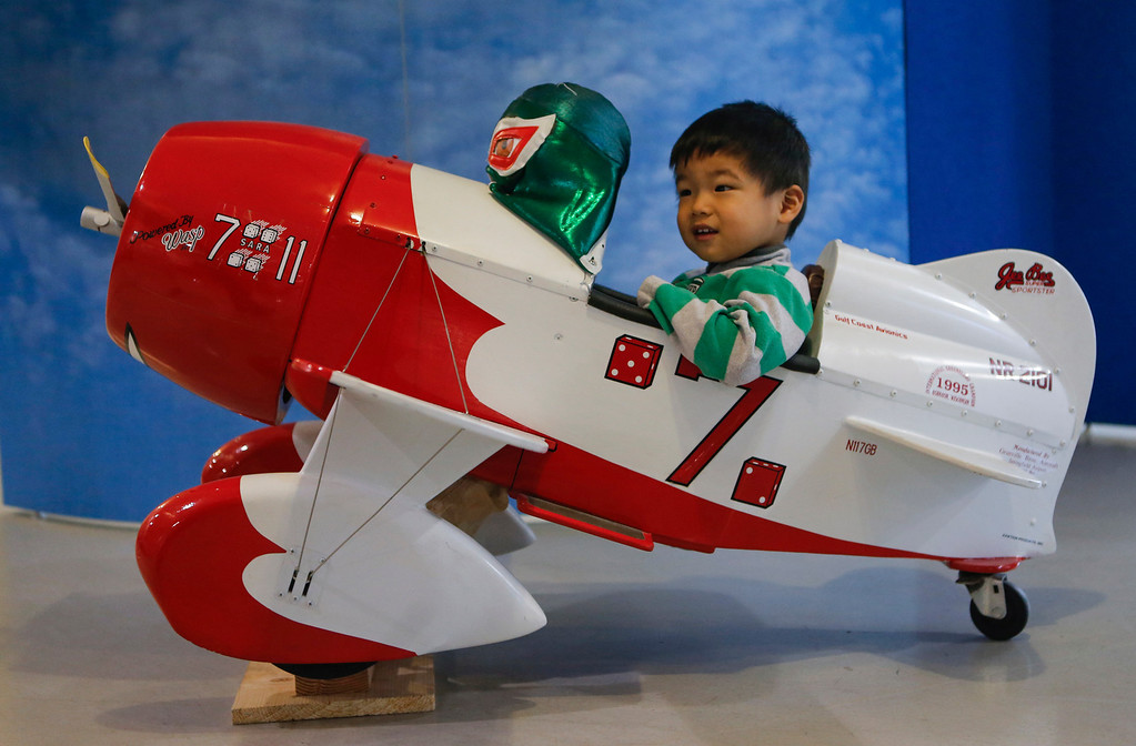 . Grant Ko, 2, sits in the replica cockpit of 1930\'s Gee Bee racing plane at the Hiller Aviation Museum in San Carlos, Calif., on Saturday, Jan. 4, 2014. Hundreds of people came out for Open Cockpit Day and got a chance to sit in the cockpit of many of the aircraft on display at the museum. (John Green/Bay Area News Group)