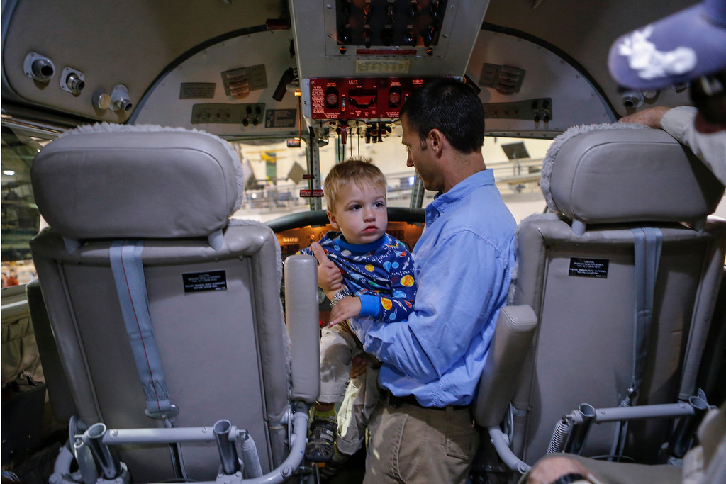 ". Matthew Debski, and son Hawkins, 1, check out the cockpit of the Gruman ""Albatros\"" amphibious airplane at the Hiller Aviation Museum in San Carlos, Calif., on Saturday, Jan. 4, 2014. Hundreds of people came out for Open Cockpit Day and got a chance to sit in the cockpit of many of the aircraft on display at the museum. (John Green/Bay Area News Group)"