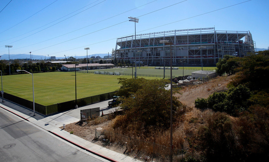 . The Santa Clara Youth Soccer Park in the shadow of the future San Francisco 49ers stadium in Santa Clara, Calif. on Thursday, Sept. 19, 2013.  The 49ers and the city of Santa Clara are proposing to develop part of the Ulistac Natural Area, 40-acre natural open space, into soccer fields to make way for extra parking where the current Youth Soccer Park is located.  (Nhat V. Meyer/Bay Area News Group)