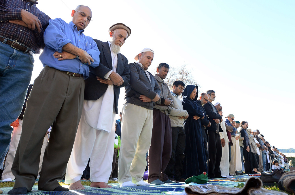 """. Muhammed Jawaid, of San Ramon, left, and Muhammed Saidwal, of Union City, second from left, were among a large group from the Muslim community taking part in a \""""Salatul Istisqa\"""" a prayer for rain held at the Alameda County Fairgrounds in Pleasanton, Calif., on Saturday, Feb. 1, 2014. Because of California\'s on going drought a prayer for rain was held by the San Francisco Bay Area chapter of the Council on American-Islamic Relations. Imam Zaid Shakir, co-founder of Zaytuna College was also one of the event\'s organizers. (Doug Duran/Bay Area News Group)"""