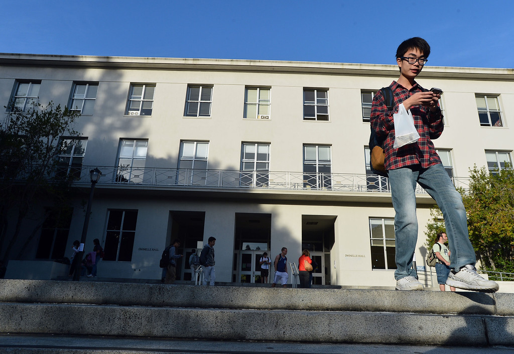 . UC Berkeley students leave Dwinelle Hall after finding it closed the morning after an electrical fire at UC Berkeley in Berkeley, Calif., on Tuesday, Oct. 1, 2013.  (Kristopher Skinner/Bay Area News Group)