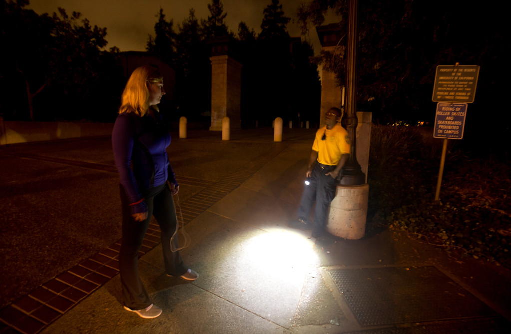 . A University of California  police officer, right, explains to an unidentified jogger that she cannot enter the campus after an explosion and fire in an underground utility vault caused a power outage and forced the evacuation, Monday, Sept. 30, 2013 in Berkeley, Calif. (D. Ross Cameron/Bay Area News Group)