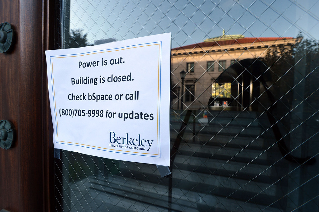 . Signs on the doors of Durant Hall at UC Berkeley inform students that it remains closed the morning after an electrical fire at UC Berkeley in Berkeley, Calif., on Tuesday, Oct. 1, 2013.  (Kristopher Skinner/Bay Area News Group)
