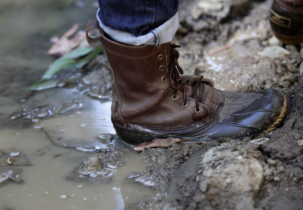 . Water gently flows downstream past a muddy boot of David Yogi along San Francisquito Creek in Menlo Park, Calif. on Thursday, Sept. 5, 2013.  (Gary Reyes/Bay Area News Group)