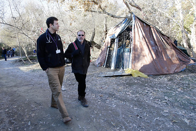 """Dr. Ari Kriegsman and psychologist, Charles Preston, right, of the Valley Homeless Healthcare Program reach out to the homeless in an encampment known as """"The Jungle"""" at Coyote Creek during a weekly visit to the tent city in San Jose, Calif. on Tuesday, Dec. 10, 2013. The program sponsored by Santa Clara County provides immediate medical care from a mobile medical unit. Outreach teams are also sent into the camps to provide medical services for those who have seldom sought medical care in the past.  (Gary Reyes/Bay Area News Group)"""