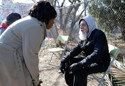 """Mercy Egbujor, nurse practitioner of the Valley Homeless Healthcare Program, talks to Erasmo Torres, 53, in a makeshift waiting room at a homeless encampment known as """"The Jungle"""" near Coyote Creek in San Jose, Calif. on Tuesday, Dec. 10, 2013. Torres has had back problems. The program sponsored by Santa Clara County provides immediate medical care from a mobile medical unit that comes to the encampment once a week. Outreach teams are also sent into the camps to provide medical services for those who have seldom sought medical care in the past.  (Gary Reyes/Bay Area News Group)"""