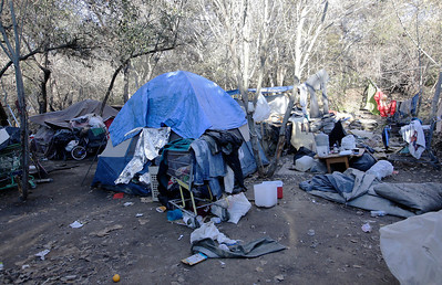 """A homeless encampment known as """"The Jungle"""" at Coyote Creek is quiet in the early morning hours in San Jose, Calif. on Tuesday, Dec. 10, 2013. Doctors from the Valley Homeless Healthcare Program sponsored by Santa Clara County were visiting the campsites to provide medical services for those who have seldom sought medical care in the past.  (Gary Reyes/Bay Area News Group)"""