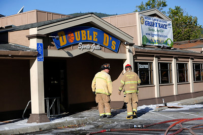 Fire investigators from the Santa Clara County Fire Department take a look at the damage caused from a three-alarm fire at Double D's Sports Grille in Los Gatos, Calif., on Monday, April 25, 2016. (Gary Reyes/Bay Area News Group)