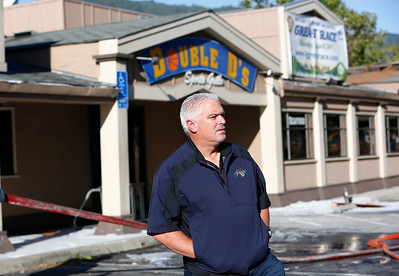 Darin Devincenzi, owner, views the damage caused from a three-alarm fire at Double D's Sports Grille in Los Gatos, Calif., on Monday, April 25, 2016. (Gary Reyes/Bay Area News Group)