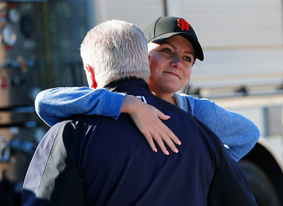 Danielle Dominguez, employee, right, hugs Darin Devincenzi, owner, after viewing the damage from a three-alarm fire at Double D's Sports Grille in Los Gatos, Calif., on Monday, April 25, 2016. (Gary Reyes/Bay Area News Group)