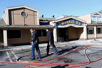 Fire personel from the Santa Clara County Fire Department prepare to take away hoses after battling a three-alarm fire at Double D's Sports Grille in Los Gatos, Calif., on Monday, April 25, 2016. (Gary Reyes/Bay Area News Group)