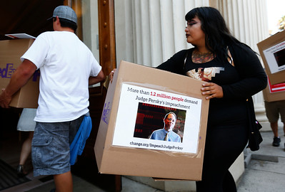 Rosemarie Ramirez carries a symbolic box of petitions calling for the impeachment of Santa Clara County Superior Court Judge Aaron Persky into the Old Courthouse in San Jose, Calif., on Monday, Aug. 1, 2016. protesters, upset by the light jail sentence he gave former Stanford student Brock Turner for sexually assaulting an unconscious woman, have submitted 1.2 million signatures in a petition to oust the judge. The actual signatures were submitted on a hard drive to save paper.(Photo by Gary Reyes/Bay Area News Group)