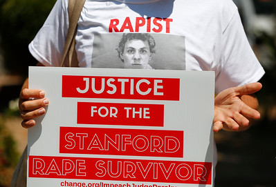 Jonathan Ross holds a picket sign during a protest asking for the impeachment of Santa Clara County Superior Court Judge Aaron Persky at the Old Courthouse in San Jose, Calif., on Monday, Aug. 1, 2016. protesters, upset by the light jail sentence he gave former Stanford student Brock Turner for sexually assaulting an unconscious woman, have submitted 1.2 million signatures in a petition to oust the judge. (Photo by Gary Reyes/Bay Area News Group)