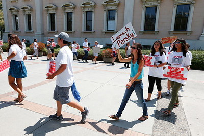 Protesters march next to the Old Courthouse demanding the impeachment of Santa Clara County Superior Court Judge Aaron Persky in San Jose, Calif., on Monday, Aug. 1, 2016. Upset by the light jail sentence he gave former Stanford student Brock Turner for sexually assaulting an unconscious woman, the group submitted 1.2 million signatures in a petition to oust  Judge Persky. (Photo by Gary Reyes/Bay Area News Group)