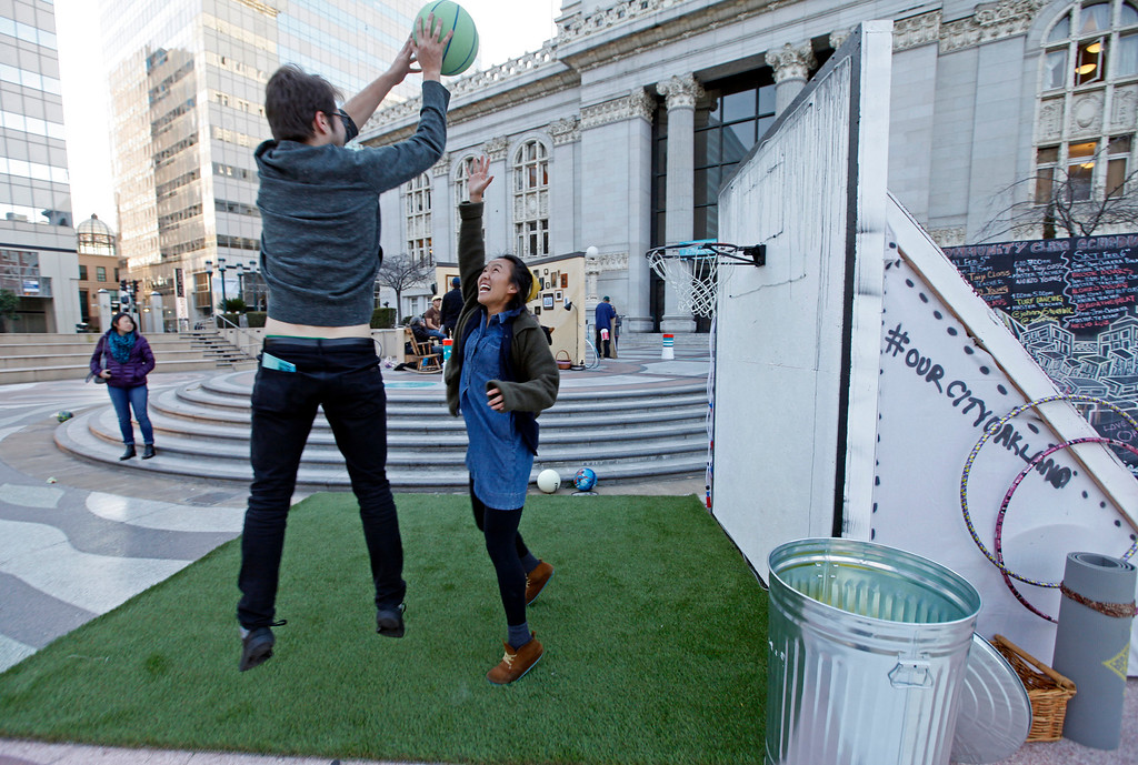 """. Antonio, left, and Stephanie, both from the South Bay, have a game of one-on-one in the \""""IT\'s LIT\""""  multigenerational playground at Frank Ogawa Plaza in Oakland, Calif.,  on Friday, Feb. 5, 2016.  The non-profit Our City partnered with the City of Oakland to bring a Public Design Fair to Oakland promoting \""""play\"""", the theme of the three-day interactive fair. (Laura A. Oda/Bay Area News Group)"""