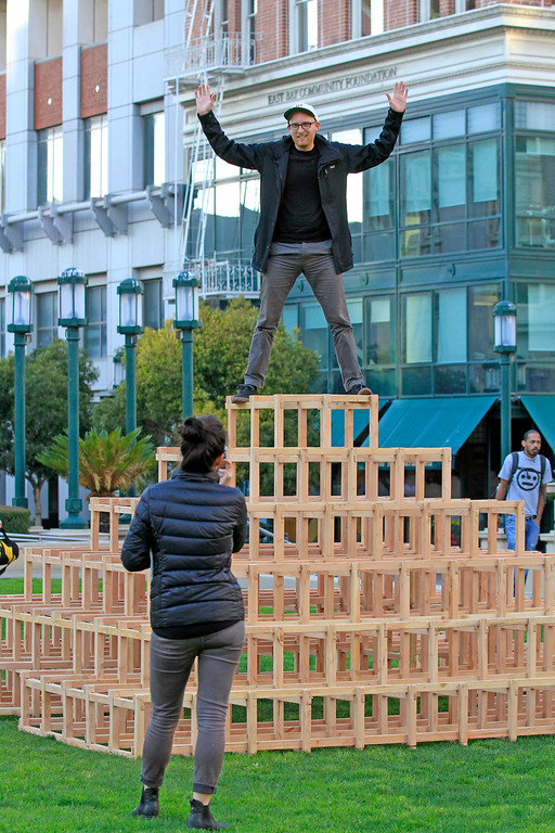 """. Nathan Gandrud from San Francisco plays King of the Mountain on the \""""Scaffoldia\"""" installation at Frank Ogawa Plaza in Oakland, Calif.,  on Friday, Feb. 5, 2016.  The non-profit Our City partnered with the City of Oakland to bring a Public Design Fair to Oakland promoting \""""play\"""", the theme of the three-day interactive fair. (Laura A. Oda/Bay Area News Group)"""