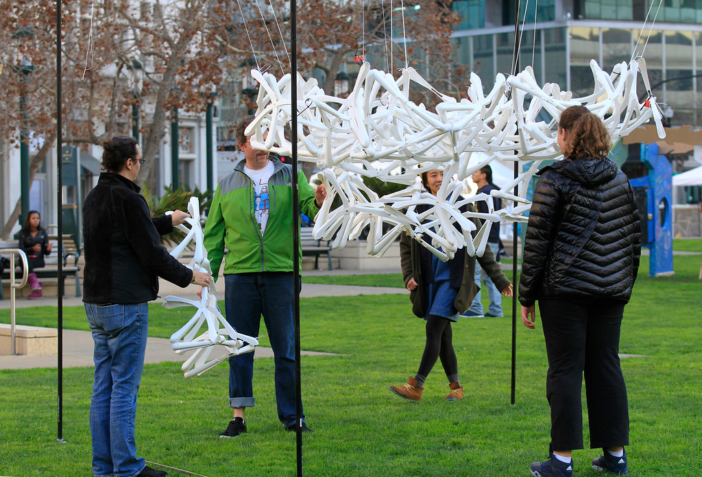 ". People explore the ""Sum of Fun\"" installation at Frank Ogawa Plaza in Oakland, Calif.,  on Friday, Feb. 5, 2016.  The non-profit Our City partnered with the City of Oakland to bring a Public Design Fair to Oakland promoting \""play\"", the theme of the three-day interactive fair. (Laura A. Oda/Bay Area News Group)"
