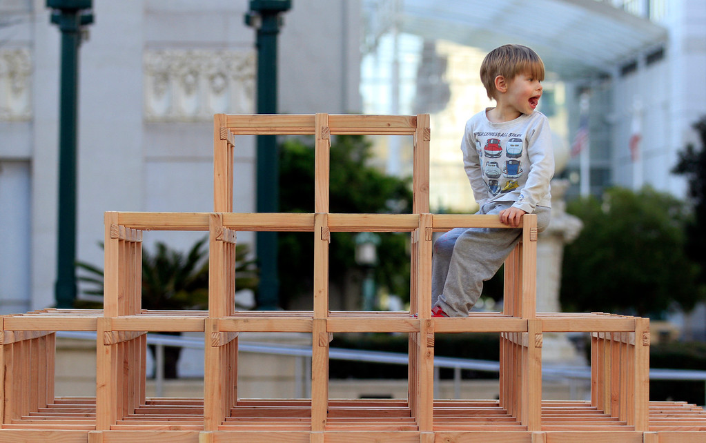 ". Rex Gramana, 3, calls to his mom after scaling the Scaffoldia installation at Frank Ogawa Plaza in Oakland, Calif., on Friday, Feb. 5, 2016.  The non-profit Our City partnered with the City of Oakland to bring a Public Design Fair to Oakland promoting ""play\"", the theme of the three-day interactive fair. (Laura A. Oda/Bay Area News Group)"