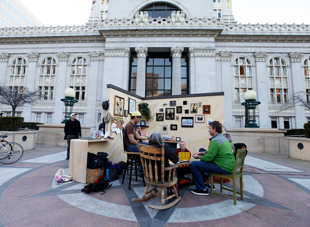 """. A gathering forms in the \""""Living Room\"""" installation at Frank Ogawa Plaza in Oakland, Calif.,  on Friday, Feb. 5, 2016.  The non-profit Our City partnered with the City of Oakland to bring a Public Design Fair to Oakland promoting \""""play\"""", the theme of the three-day interactive fair. (Laura A. Oda/Bay Area News Group)"""