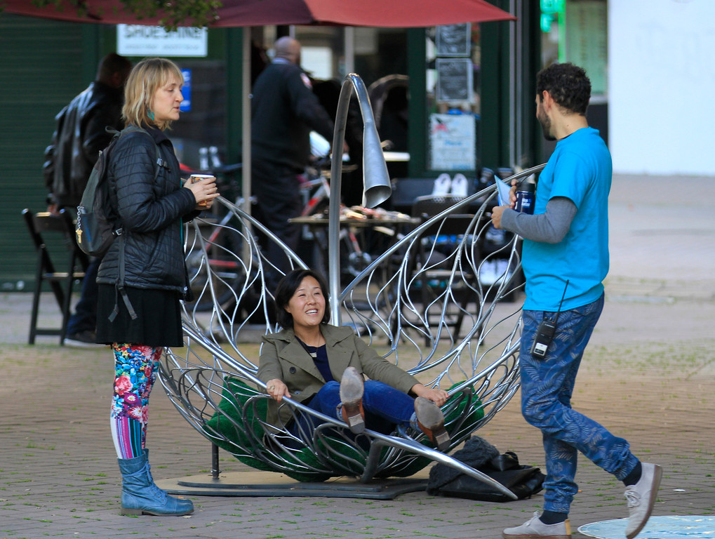 """. People relax in the \""""Tumble Leaf\"""" installation at Frank Ogawa Plaza in Oakland, Calif.,  on Friday, Feb. 5, 2016.  The non-profit Our City partnered with the City of Oakland to bring a Public Design Fair to Oakland promoting \""""play\"""", the theme of the three-day interactive fair. (Laura A. Oda/Bay Area News Group)"""