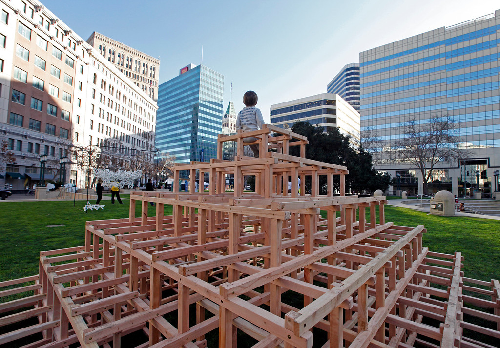 """. Rex Gramana, 3, takes in the view from a top the \""""Scaffoldia\"""" installation at Frank Ogawa Plaza in Oakland, Calif., on Friday, Feb. 5, 2016.  The non-profit Our City partnered with the City of Oakland to bring a Public Design Fair to Oakland promoting \""""play\"""", the theme of the three-day interactive fair. (Laura A. Oda/Bay Area News Group)"""