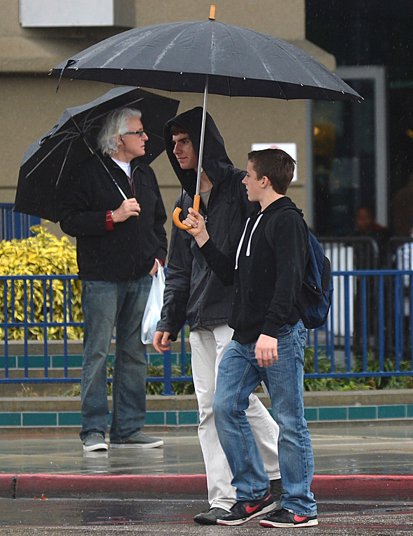 . Umbrellas cover the heads of people leaving the Brenden Theatre in the rain in Concord, Calif., on Saturday, Feb. 8, 2014. (Dan Rosenstrauch/Bay Area News Group)