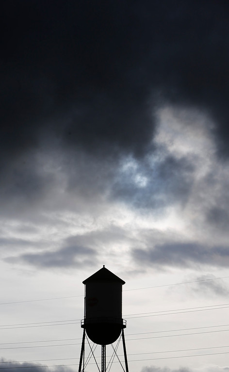 . The old Del Monte water tower is silhouetted by storm clouds in San Jose, Calif., on Sunday, Feb. 9, 2014. While the sky was full of rain clouds, very little rain made it to the ground during the day. (Jim Gensheimer/Bay Area News Group)