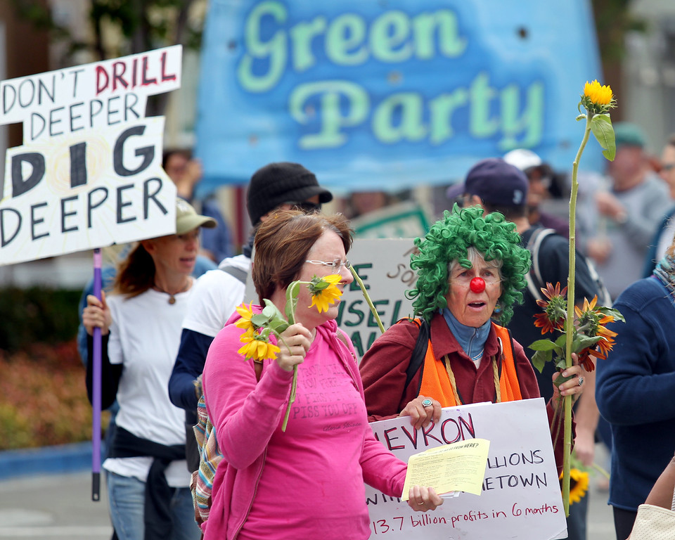 . Janet Weil, left, of Concord, and Phyllis Greenleaf, of Santa Cruz, along with 500 demonstrators march to the Chevron refinery after a rally at Richmond BART station in Richmond, Calif., on Saturday, Aug. 3, 2013.  (Ray Chavez/Bay Area News Group)