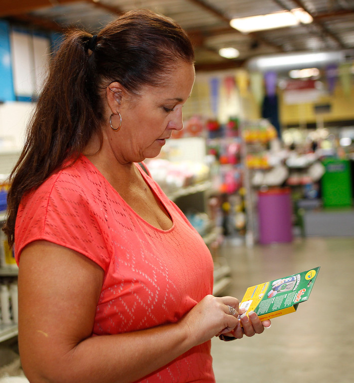 . Science teacher in Gilroy Cheryl Osborne looks at price of fabric markers at Resource Area For Teaching in San Jose, Calif., on Saturday, Aug. 10, 2013. (Josie Lepe/Bay Area News Group)