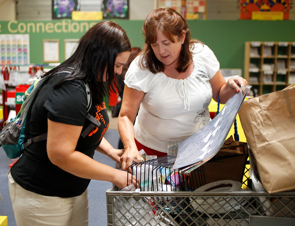 . Clovis Unified science teachers Mary Nelson, left, and Lynn White go over supplies they will be purchasing at Resource Area For Teaching in San Jose, Calif., on Saturday, Aug. 10, 2013. (Josie Lepe/Bay Area News Group)